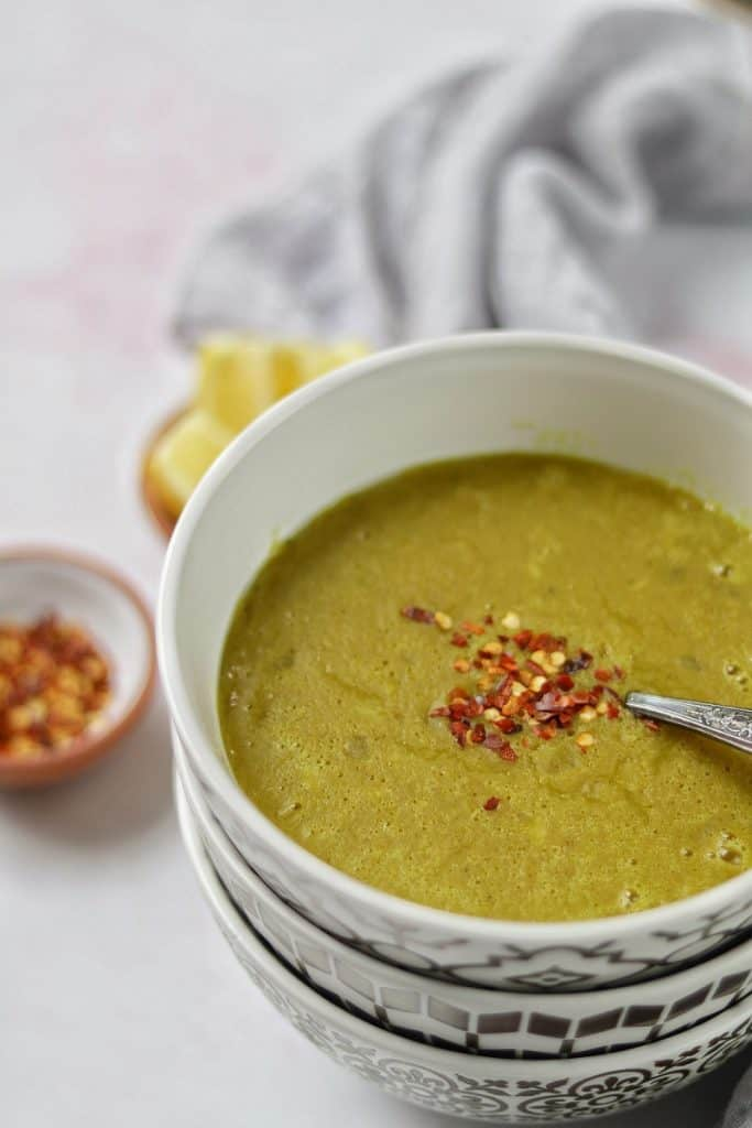delicious mediterranean red lentil soup served with crunchy pita bread