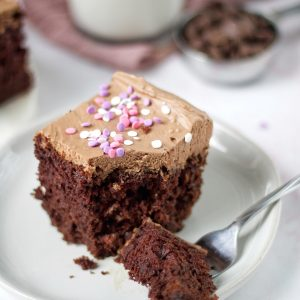 moist chocolate cake with whipped cream frosting